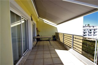 Terrace in front of lounge with sun blinds